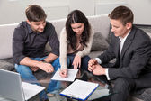 Agent advises the couple, signing documents — Stock Photo