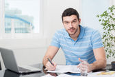 Handsome young interior designer at workplace — Stock Photo