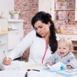 Mother and baby in home office — Stock Photo #33268901