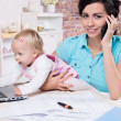Business woman with laptop and her baby girl — Stok fotoğraf #33269399