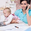 Stock Photo: Business womwith laptop and her baby girl