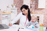 Mother and baby in home office — Stock Photo