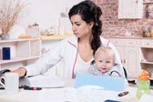 Woman With Baby Working From Home — Stock Photo
