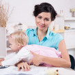 Business woman with laptop and her baby girl — Stock Photo