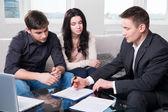 Agent advises the couple, signing documents — Stock Photo