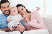 Happy young family with baby — Stock Photo