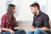Quarreled couple in their living room — Stock Photo