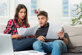 Couple calculating their domestic bills at home — Stock Photo