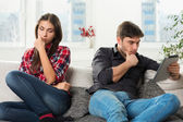 Young couple in conflict, a guy with a tablet — Stock Photo