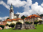 Church and fountain in Kremnica — Stock Photo
