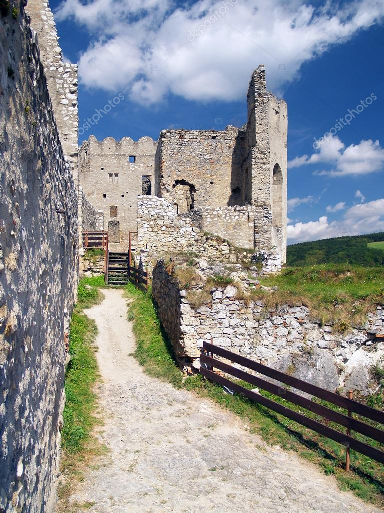 Summer view of archaeologically preserved interior of ruined Beckov Castle. The Castle of Beckov is popular castle ruin situated in village Beckov, Trencin region, western Slovakia. — Stock Photo #13155640