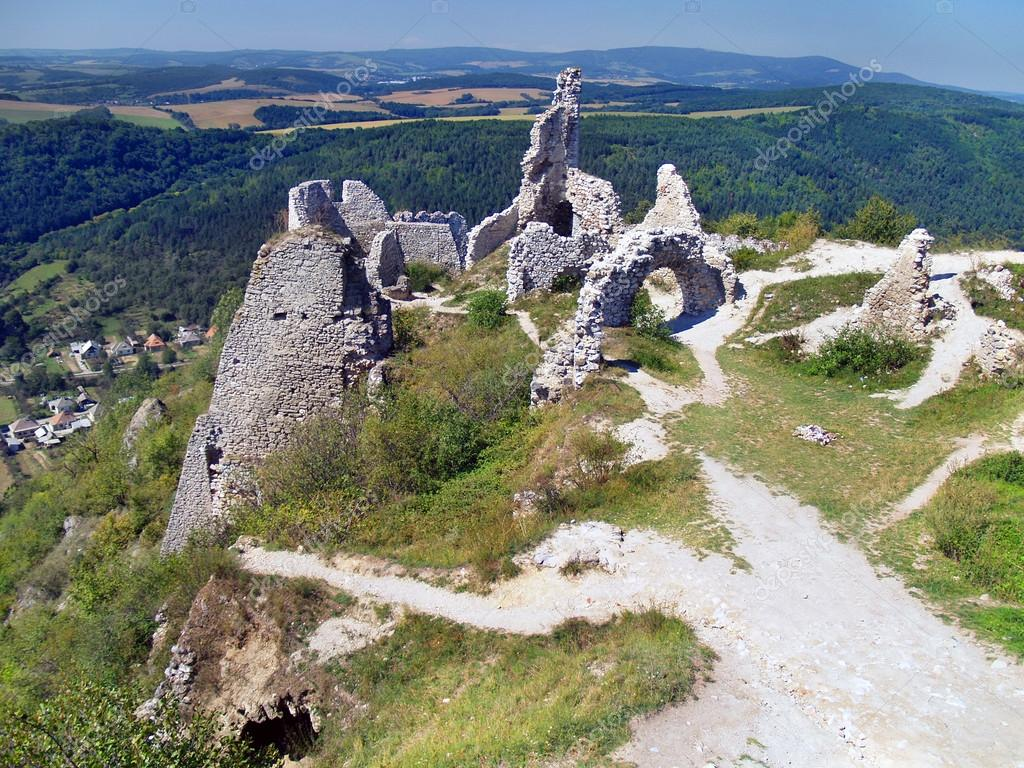 Panoramic summer view from ruined interior of The Castle of Cachtice. The Castle of Cachtice was residence and later the prison of the world famous Countess Elizabeth Bathory. The ruins of this castle was also featured in many popular movies. — Stock Photo #13188350