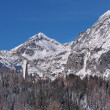 Peaks of High Tatras and Ski jump - Stock Photo