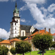Main square, church and castle in Kremnica - Stock Photo