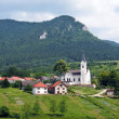 Church and hill in Valaská Dubová — Stock Photo