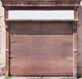 Rusty roller blind of historical shop — Stock Photo