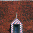 Colorful window on tiled roof — Stock Photo