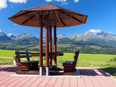 Benches under shelter and High Tatras — Stock Photo