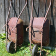 Two wheelbarrows at wooden barn — Foto de Stock