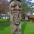 Stock Photo: Totem pole carved from cedar