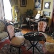 Table and chairs in a Victorian parlor — Stock Photo
