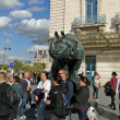 Стоковое фото: Rhinoceros and tourists gather