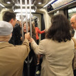 Passengers ride the underground metro train — Stock Photo