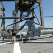 Stock Photo: Civilians inspect AH-1W Super Cobrhelicopter