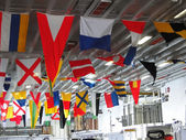 Signal flags displayed on the hangar deck — Stock Photo