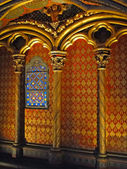 Patterned walls and stained glass window — Stock Photo