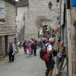 Tourists walk on the medieval streets — Stock Photo