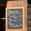 Savoyard specialties on the menu — Stockfoto