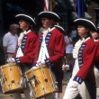 Drummers in red and white colonial uniforms — Stock Photo #12873316