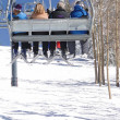 Skiers ride the chairlift — Stock Photo