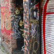 Urban graffiti murals brighten Old Town's alleys — ストック写真