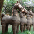 Terra cotta horses in folk art garden — Stock Photo