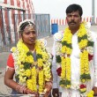 Bride and groom visit the Shiva Murga temple on their wedding day — Stock Photo