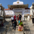 Stock Photo: Indipilgrims descend temple stairs