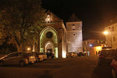 Medieval castle walls lit at night — Stock Photo