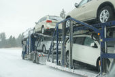 Large trucks fight a winter storm — Stock Photo