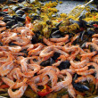 Shrimp, mussels and paella — Stock Photo
