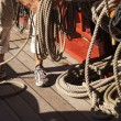 Sailor coils a line after setting sail — Stock Photo #13320815