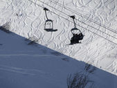 Chairlifts on high mountain ski area — Stock Photo