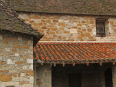 Tiled roof and stone wall of the cloister — Stock Photo