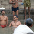 Hindus perform ritual puja at dawn in the Ganges River - Stockfoto
