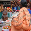 Stock Photo: Hindu women browse market