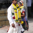 Stock Photo: Bride and groom visit ShivMurgtemple on their wedding day