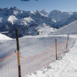 Stock Photo: Snow fence lines piste