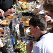 Stock Photo: Skiers enjoy lunch outdoors