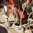 Sailor coils a line after setting sail — Stock Photo